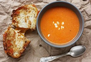 Artisan Grilled Cheese &amp; Tomato Bisque<br /> sliced sourdough  |  Irish cheddar  |  fontina<br /> peppercorn cheddar |  fresh spinach<br /> caramelized onions  |  rustic tomato soup